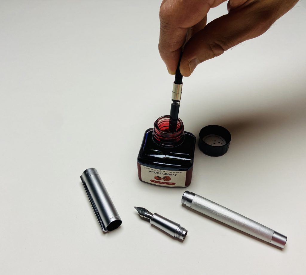 Filling a fountain pen converter cleanly