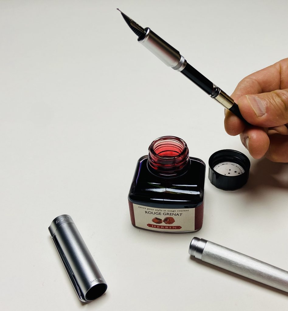 Nib section with converter inserted