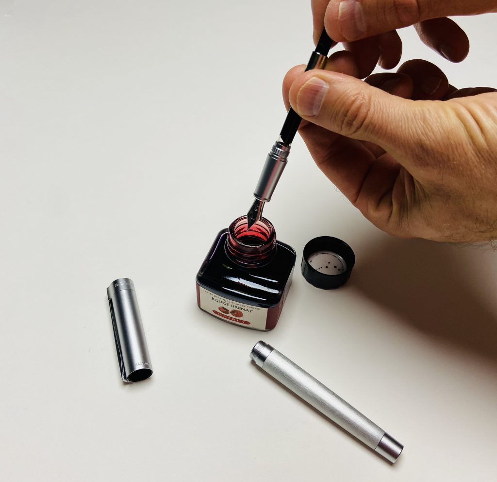 Drawing ink through the fountain pen nib and feed